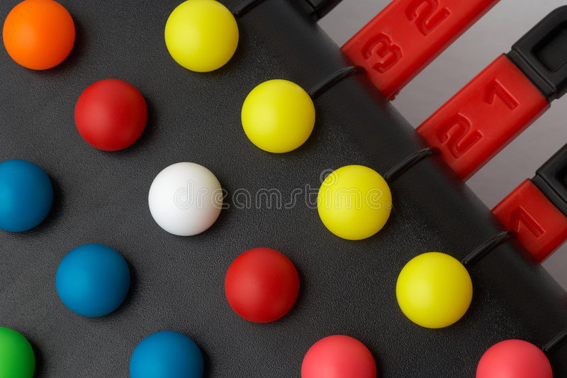 Problem solving puzzle game. A close-up of the colorful balls of a problem solving puzzle game stock photo