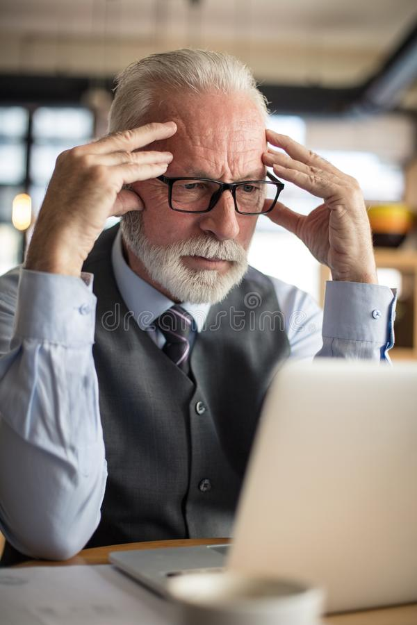 Problem at work. Big business makes problems. Senior businessmen stock photos