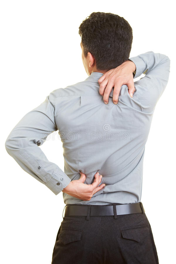 Problems with the back. Man standing with pain in his back royalty free stock photos
