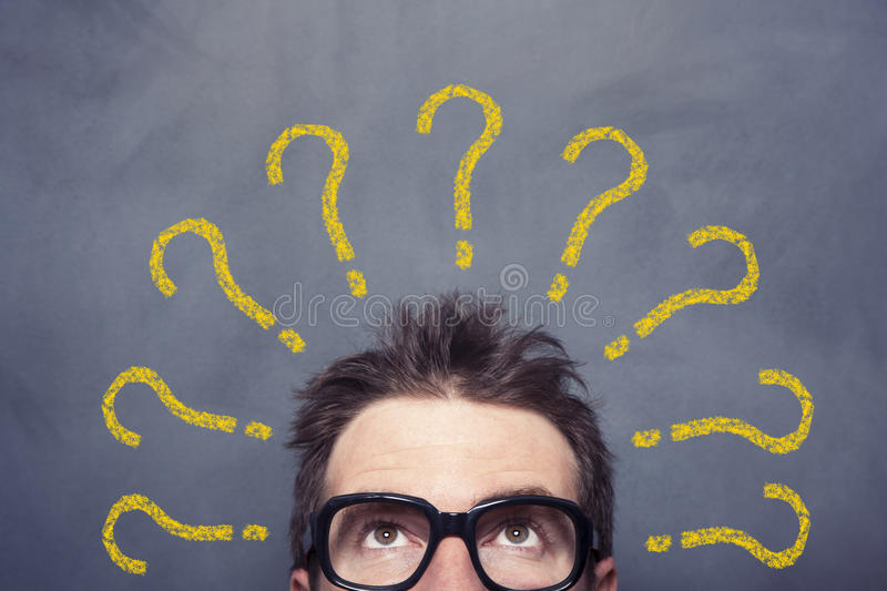 Problems. Businessman front of the blackboard problems concept royalty free stock image