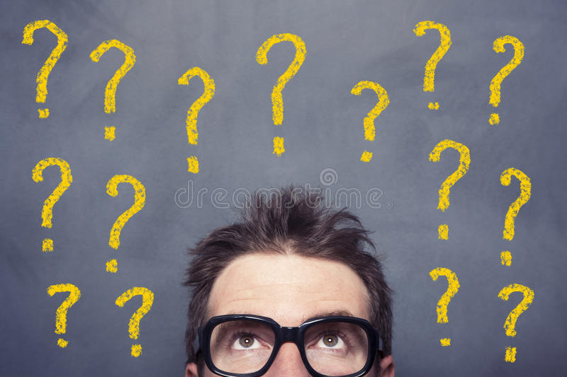 Problems. Businessman front of the blackboard problems concept stock photography