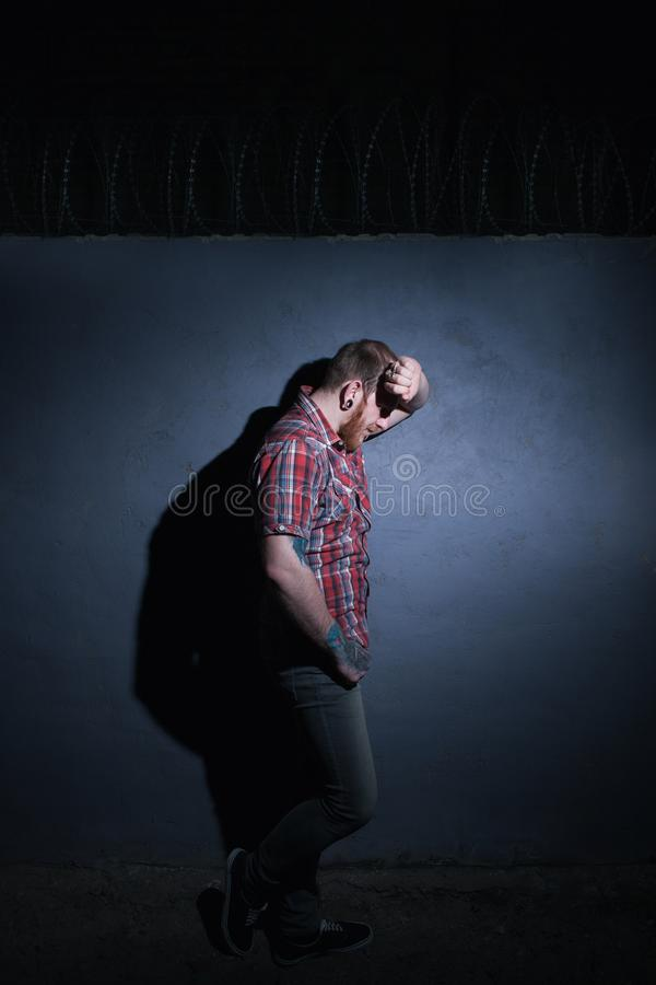 Problems in life. Tired male in prison stock photography