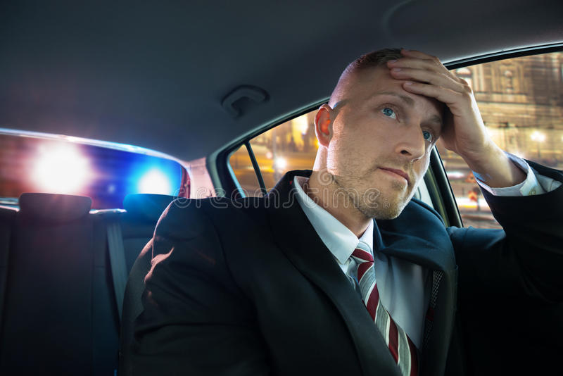Problems with police. Stressed Young Driver Has Problems With Police royalty free stock image