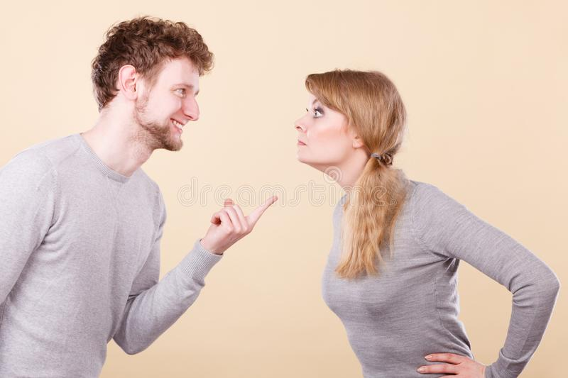 Young emotional couple arguing. Problems in relationship. Young blonde couple arguing and yelling on each other. Emotional way to express bad feelings stock image