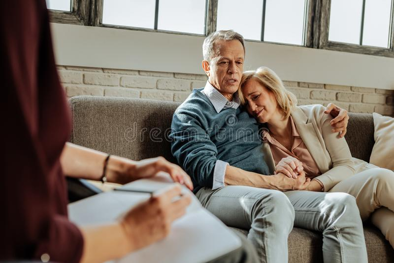 Desperate good-looking couple having crises in their relationship. Problems in relationships. Desperate good-looking couple having crises in their relationship stock images