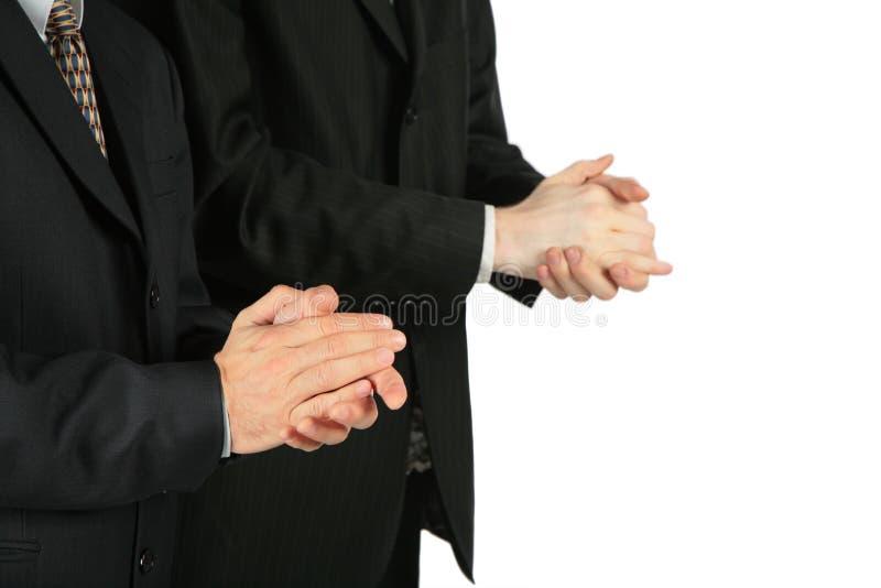 procès de applaudissement deux d'hommes photographie stock libre de droits