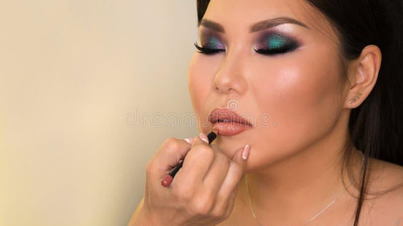 Proc?d? de cr?ation d'image Maquillage photo stock