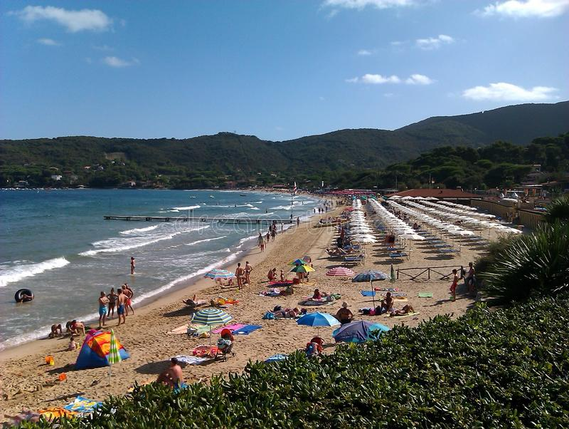 Procchio Isola De Elba Italy. Beach in Procchio Isola De Elba Italy on a sunny day with scattered clouds royalty free stock photography