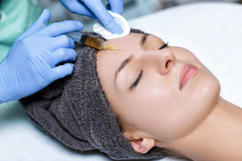 Procedure Plasmolifting injection. plasma injection into skin o. Procedure Plasmolifting injection. plasma injection into the skin of the forehead of the patient royalty free stock image