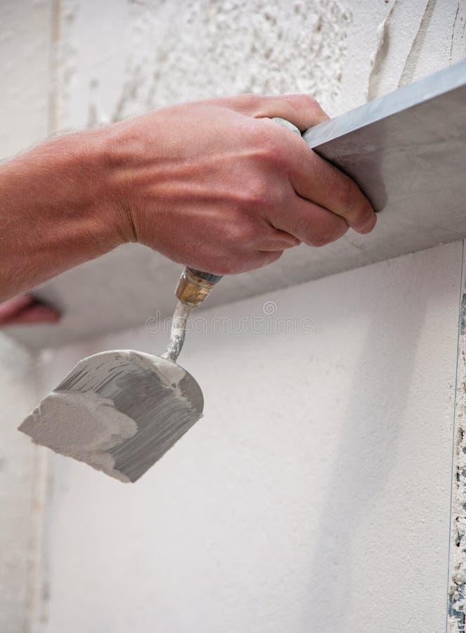 Proces gipsować ściany obraz stock