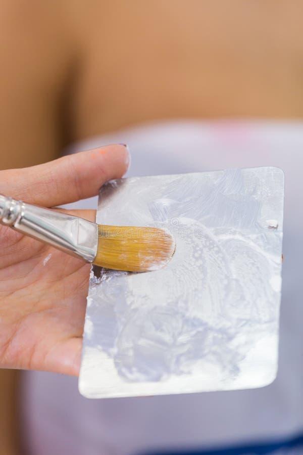 Proces kładzenia airbrush uzupełniał fotografia stock