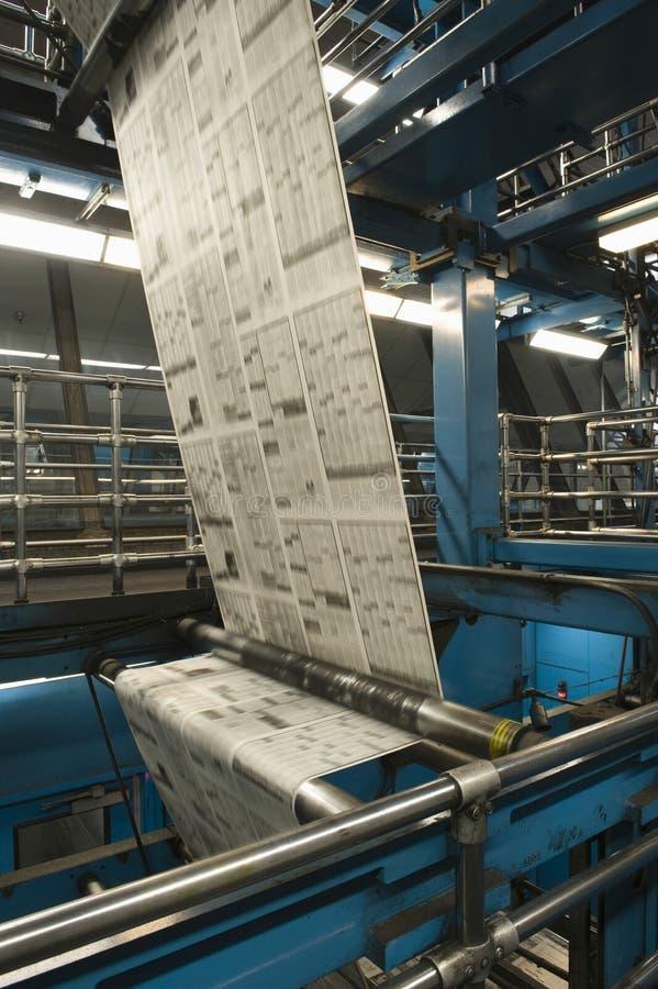 Proceso de la producción del periódico fotos de archivo