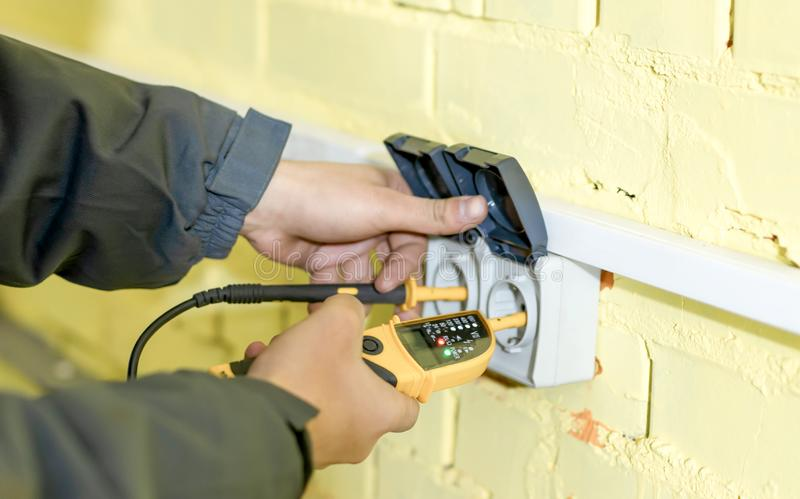 The process of checking the connection of cables to a dual outlet. On a yellow background stock images