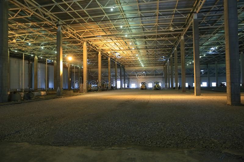 The process of construction and launch of a large logistics center, its internal filling and finishing stock photo