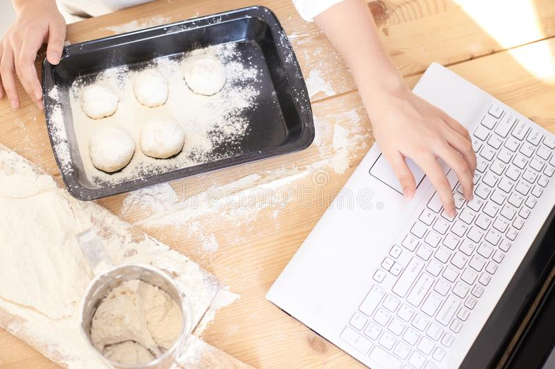 Process of cooking buns. Raw dough. White flour. Bright laptop royalty free stock photography