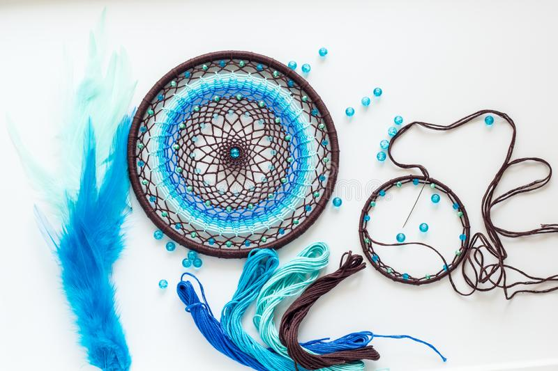 Process of creating a dream catcher. Dreamcatcer handmade. Art Creativity Hobby Workshop Handicraft Decoration Concept stock image