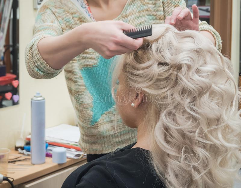 Process of creating a female hairstyle. royalty free stock photography