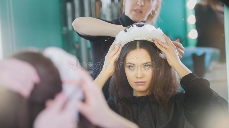 The process of creating a hairstyle with hairdressing accessories royalty free stock photo