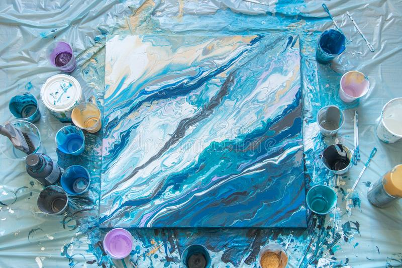The process of creating a picture of abstraction in the fluid art liquid acrylic stock photos