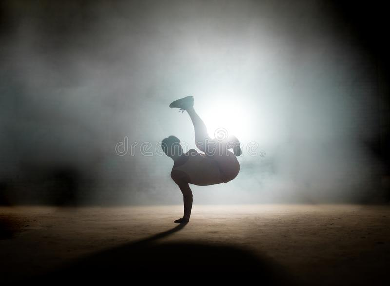 Process of doing freeze without difficulties. Demonstate skills. mixture of coordination. dancing element stock photo