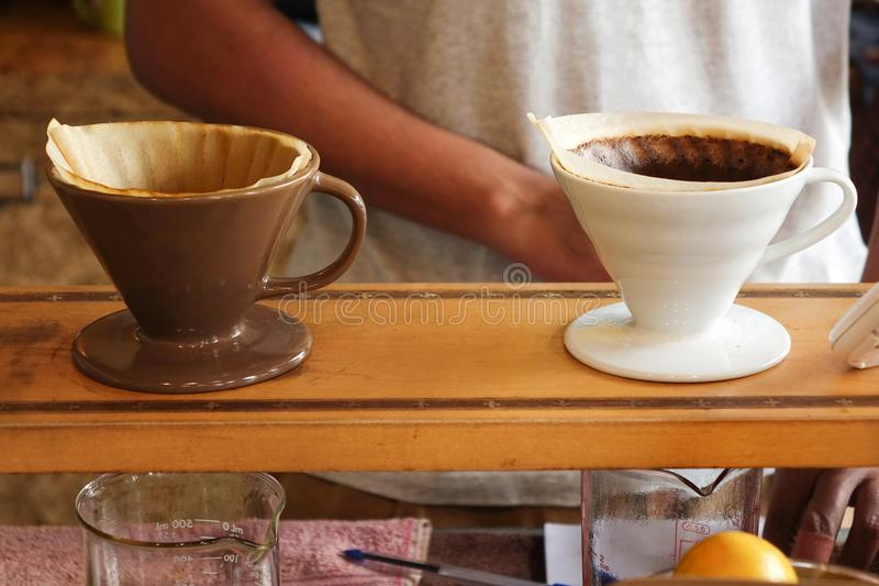 Process of dripping coffee on stand stock photography