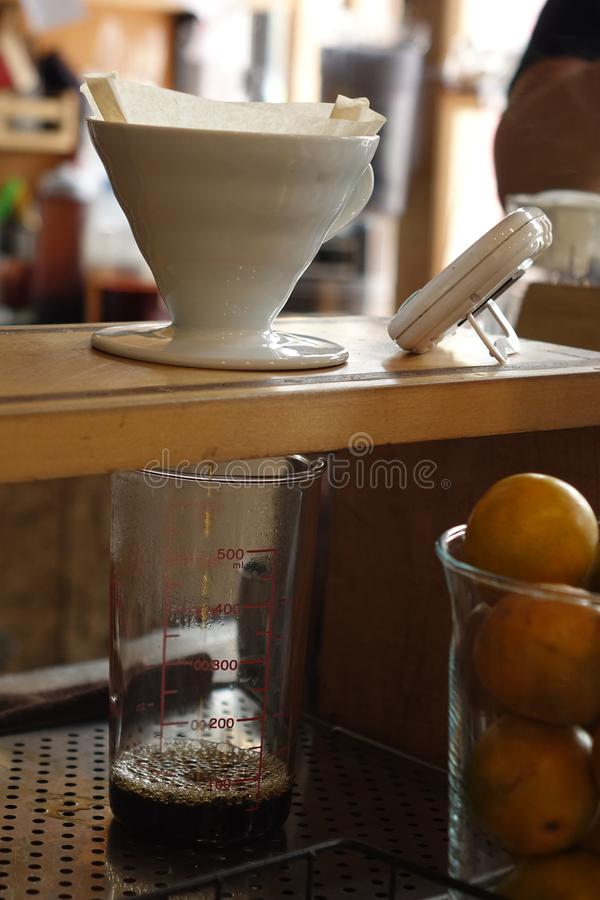 Process of dripping coffee on stand stock image