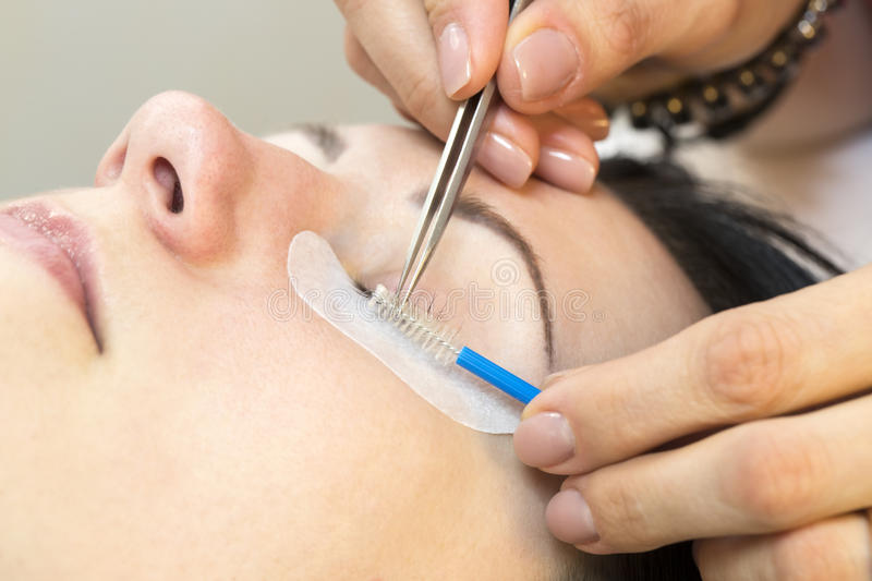 The process of eyelash extensions royalty free stock images