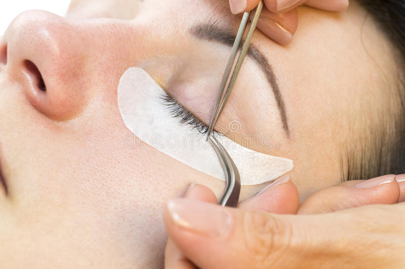 The process of eyelash extensions royalty free stock image