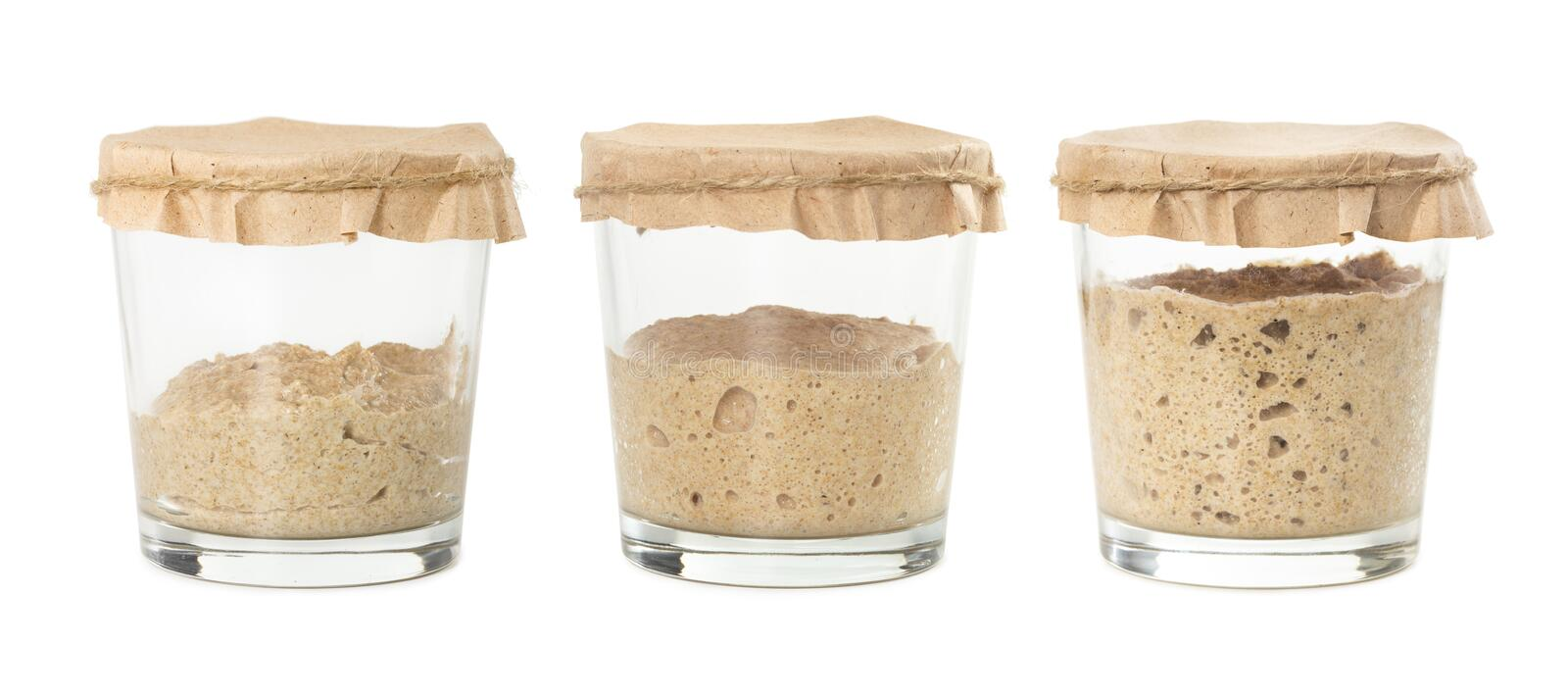 Process of fermentation of homemade rye bread sourdough isolated. On white background. Active rye starter for bread. Healthy eating concept stock photos