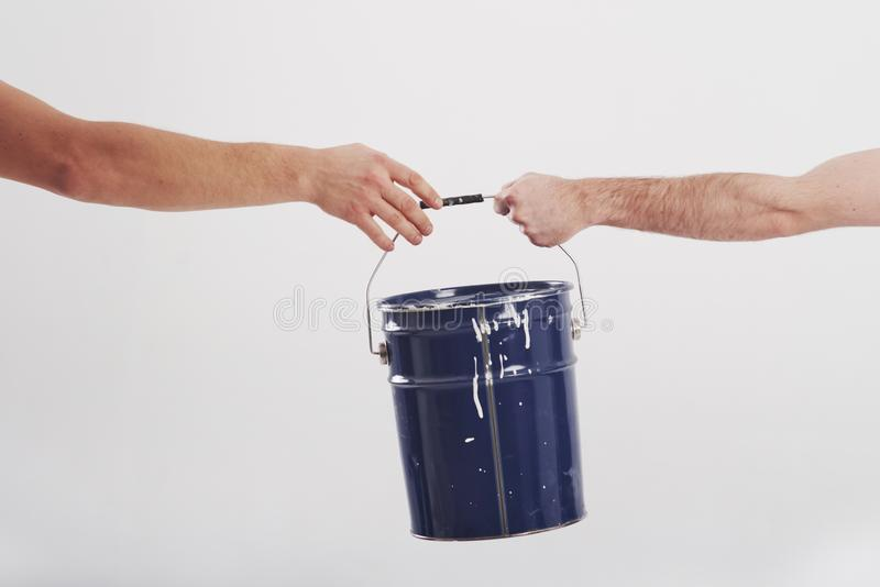 Process of giving paint to other person. Concept of repairing and new house.  royalty free stock photo