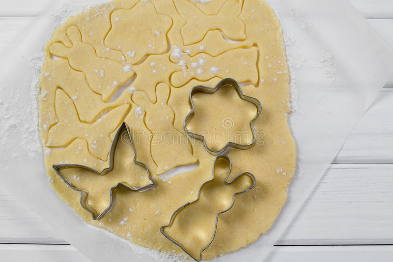 Process of making Easter cookies from raw dough. Cut Easter figures stock photography