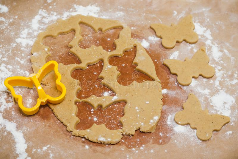 The process of making ginger cookies in the form of butterfly, gingerbread royalty free stock images