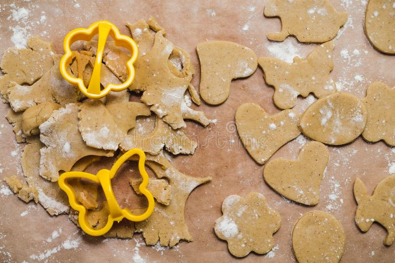 The process of making ginger cookies in the form of a heart, flower, butterfly, egg and rabbit, Gingerbread.  stock image