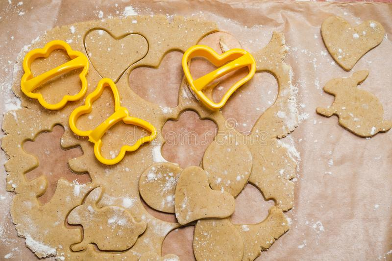 The process of making ginger cookies in the form of a heart, a flower, a butterfly and a rabbit, gingerbread.  royalty free stock images