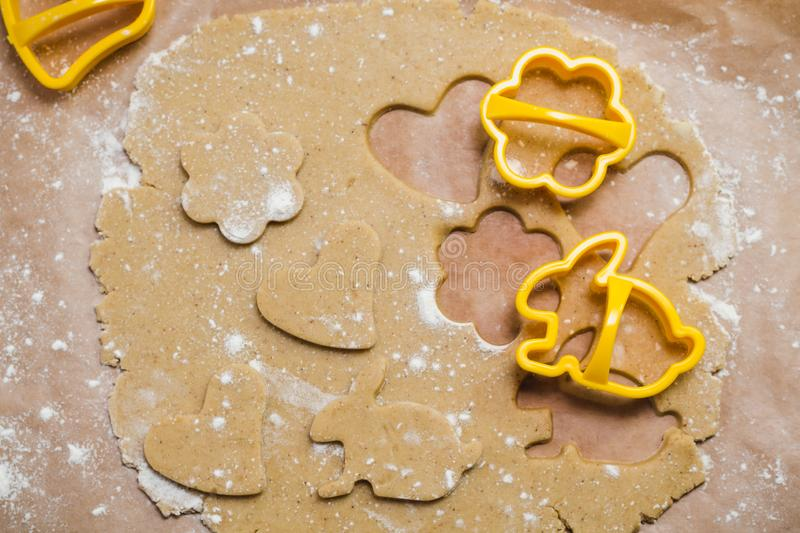 The process of making ginger cookies in the form of a heart, flower and rabbit, Gingerbread.  royalty free stock images