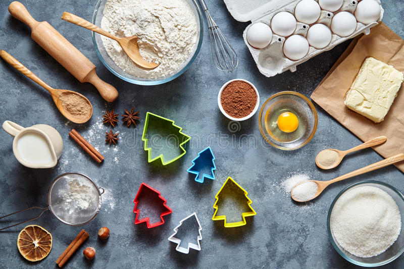 The process of making gingerbread Christmas tree cookies. Bake sweet cake dessert concept. Top view, flat lay style stock images