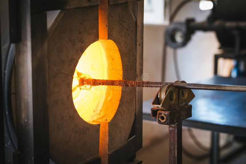 Glass making process. The process of making glass culptures stock images