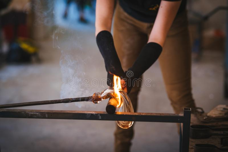 Glass making process. The process of making glass culptures royalty free stock images