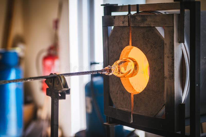 Glass making process. The process of making glass culptures stock photos