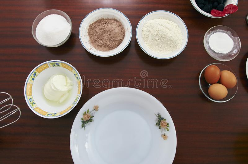 The process of making pie dough by hand. Baking cake in a kitchen dough recipe ingredients eggs, flour, milk, butter, sugar on stock photos