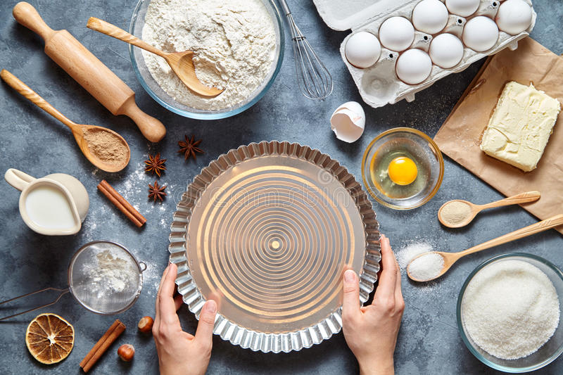 The process of making tart pie dough by hand. Baking cake in kitchen. Top view. royalty free stock photos