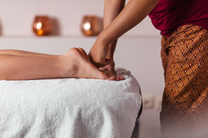 Process of massaging feet in the beauty salon stock images