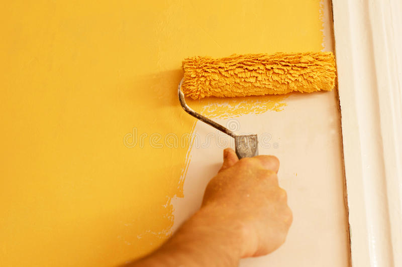The Process Of Painting The Walls In Yellow Color Stock Image ...