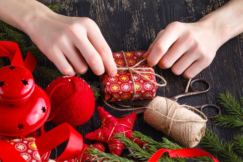 The process of preparing Christmas gifts. Kid hands royalty free stock images