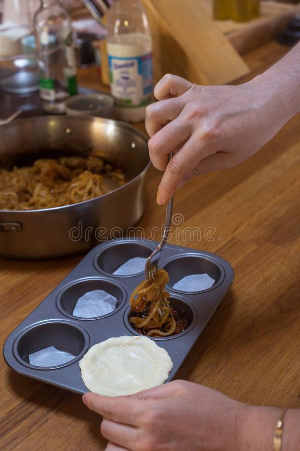 Process of preparing pie with tomatoes hands wooden table. Natural light stock photography