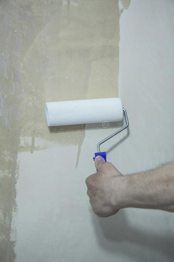 Process of priming plastered surface stock photo