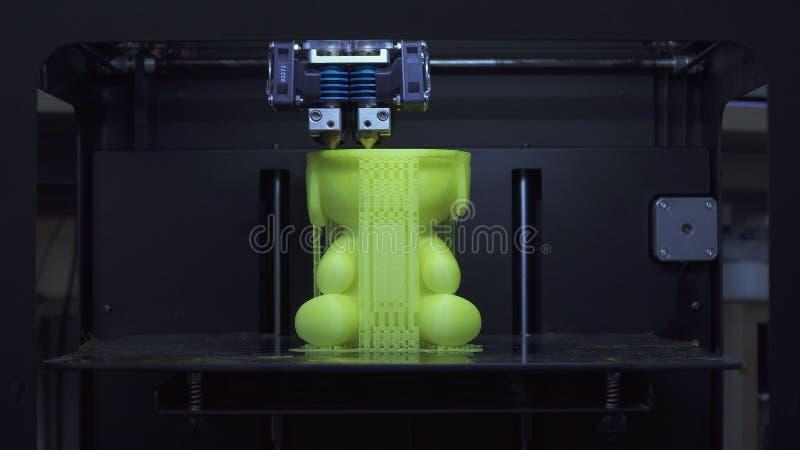 Process of printing on 3D printer stock image