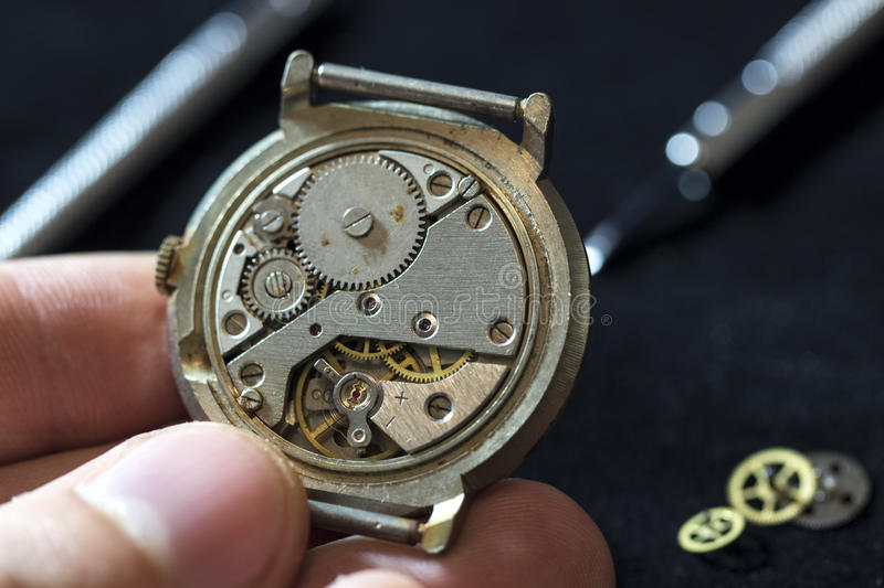 The process of repair mechanical watches. The process of repair of mechanical watches in macro royalty free stock image