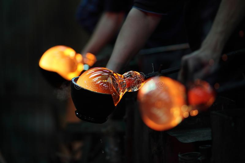 Process of shaping glass during handmade production stock photography