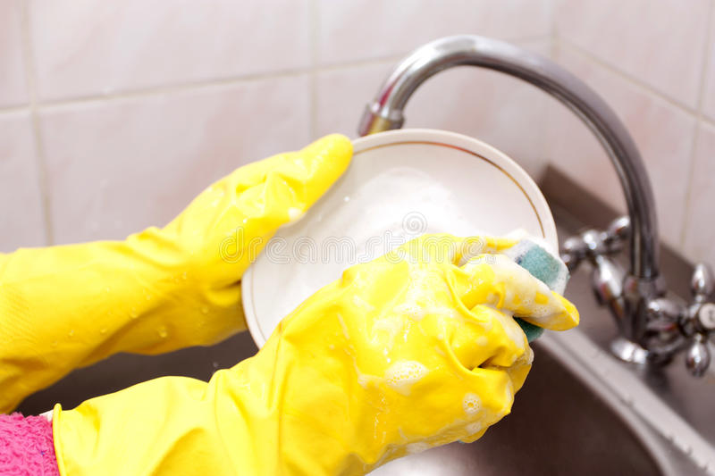 Process of washing of ware. In a sink on kitchen royalty free stock images
